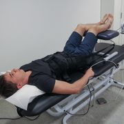 Spinal traction (stretching the spine)